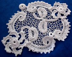 Piece of Irish Crochet lace: motif connected.