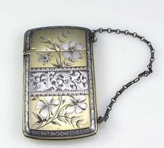 "Wood and Hughes sterling card case ~ sterling silver card case with original chain. Engraved with Japanese-style decoration of flowers and insects. 4"" by 2 1/4"". $ 650.00 [1st of two pins]"
