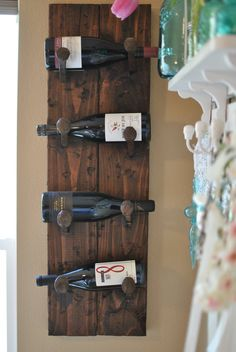A salvaged board with railroad spikes creates a rustic wine rack. Railroad Spikes Crafts, Railroad Spike Art, Railroad Ties, Diy Projects To Try, Home Projects, Pallette, In Vino Veritas, Barn Wood, Rustic Decor