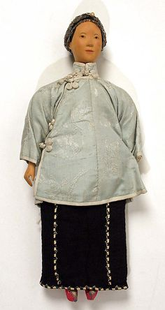 Doll, 20th c., Chinese, wood and silk
