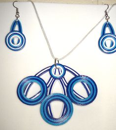 quilled set with pendant and earrings. varnished.