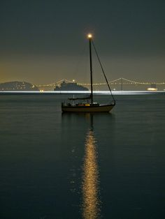 How I wish I was the one that had captured this photograph......A quiet peaceful full moon night on the San Francisco bay near Sausalito. Treasure and Alcatraz islands are silhouetted against the SF Bay Bridge on the horizon.