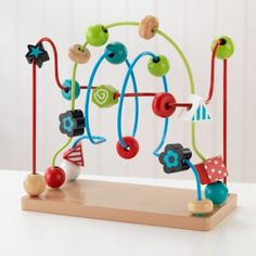 Bead Maze - Kidkraft colorful, wooden Bead Maze toy is the perfect way to introduce your child to colors and shapes, improve their hand-eye coordination and keep them engaged. The colorful beads are made from solid wood in the shapes Educational Toys For Toddlers, Preschool Toys, Toddler Toys, Kids Toys, Boy Toys, Maze Game, Ideal Toys, Toys Online, Play To Learn