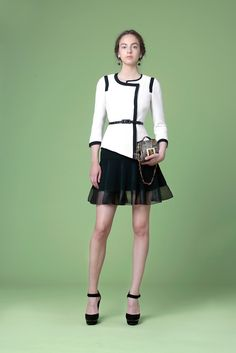 Andrew Gn Resort 2015 - Look 23 - structured duochromatic (is that a word?) jacket with flounced black skater skirt. So classy!