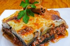 Mousakas. A greek specialty with aubergines, minced meat, bechamel sauce and potatoes.