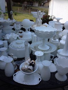 Milk glass center pieces... 20 center pieces. Several sizes and shapes. Various prices. $10-35. Each inquire at mylatdadesigns@yahoo.com