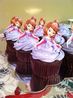 My version of the sofia the first cupcakes!  Using invitations as toppers worked well!