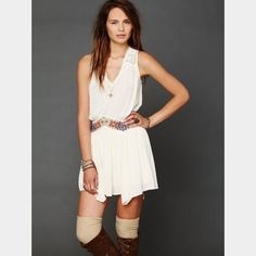 Drop waist free people dress This dress is sold out!! Beautiful drop waist with embroidered detailing. Waist is very slenderizing. Also lace detailing on shoulder. Never worn Free People Dresses
