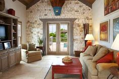 A photograph showing the French doors, which lead from the living room to the pool terrace at Ballyhoo Cottage, Providenciales (Provo), Turks and Caicos Islands, BWI.