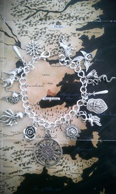 Hey, I found this really awesome Etsy listing at http://www.etsy.com/listing/167302477/game-of-thrones-charm-bracelet