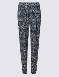 Tapered trousers are designed to flatter. Keep the rest of your look pared back next to the print of these trousers.