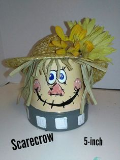 tall hand painted Terra cotta pot with raffia, straw hat and artificial sunflowers. Thanksgiving Crafts, Fall Crafts, Halloween Crafts, Holiday Crafts, Thanksgiving Decorations, Halloween Ideas, Painted Clay Pots, Painted Flower Pots, Flower Pot Crafts