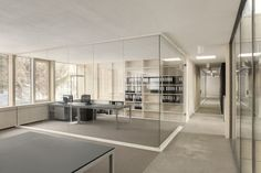 glass allows for energy efficiency (i think) and don't close off the place given the numerous office rooms