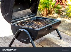 http://www.shutterstock.com/pic-241705195/stock-photo-the-portable-barbecue-on-the-wooden-table.html?src=z1Js5wcK9d…