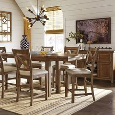 That Furniture Outlet - Minnesota's #1 Furniture Outlet. We have exceptionally low everyday prices in a very relaxed shopping atmosphere. Ashley Moriville 9 Piece Rect DRM Counter Height Dining Set http://ift.tt/2bbD6DE #thatfurnitureoutlet  #thatfurniture  High Quality. Terrific Selection. Exceptional Prices.