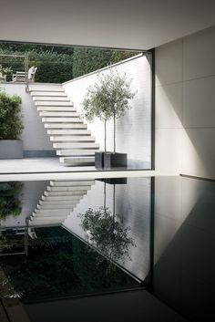 stairs pool reflection courtyard white brick minimal
