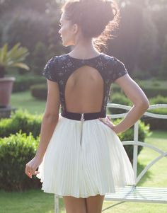 White or white/black dress with puffy skirt and open back
