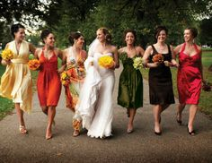 Bridesmaids don't have to have matching dresses in order to coordinate and look good together. These dresses are unified by being the same length and halter top.