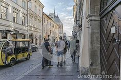 Mikołajska Street in the old part of Krakow city in Poland. Europe. Street whith pubs shops, restaurants hotels and church .Road leading to the main market square.