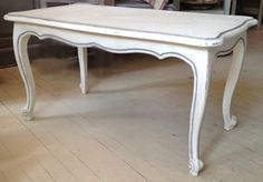 A long low French table with good moulding and distinctive cabriole legs painted in Old White and hilightened Aubusson Blue in the moulding with clear and dark wax with some distressing.