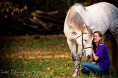 Horse and owner showing their affection with each other. Annapolis Kent Island Maryland High School Senior Portrait Photography with Horse Pet by photographer Leo Dj