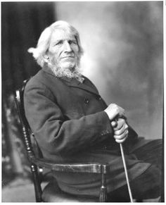 Mr. Ole Tronsedth [189-?]  Elderly man with long white hair and beard, seated in chair, holding a cane.  Likely taken by John McCarthy.  Cite as: Fred Hultstrand History in Pictures Collection, NDIRS-NDSU, Fargo.  Gift; Verwest, Donna Jean 1969.  Ole Rasmus Thronsedt was born in Norway, likely at Meraker. He and his wife Sara came to the Milton, N.D. area in 1882 with their ten children.