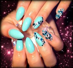 tiffany blue almond nails...  maybe without so much bling.