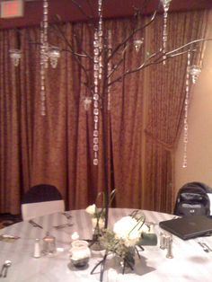 wrought iron trees with crystals and candles ~ rental item from Elysian Fields Specialty Florals