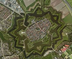 Naarden is a municipality and a town in the Gooi region in the province of North Holland in the Netherlands. Naarden is an example of a star fort, complete with fortified walls and a moat. The walls and the moat have been restored and are in a very good state.