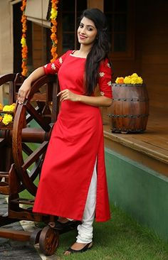 Parul - Its all about the details! Lotus embroidered handloom red kurti enhanced with line embroidery on the neckline. Simple Kurti Designs, Kurta Designs Women, Salwar Designs, Kurti Designs Party Wear, Red Kurti Design, Kurta Neck Design, Dress Neck Designs, Blouse Designs, Churidhar Designs