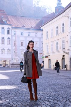 Ljubljana Slovenia architecture streets Fashion blogger Veronika Lipar of Brunette From Wall Street sharing her red outfit ideas