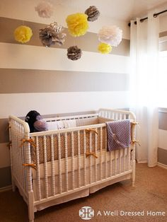 Emily Hewett, an interior designer, of A Well Dressed Home conceived this neutral, modern nursery design following the new mom's vision of a gray and yellow nursery.