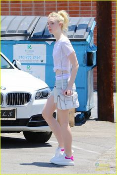 Elle Fanning Boasts Creatures Of The Wind Fashion Brand: Photo Elle Fanning arrives for a hair appointment at Ramirez Tran Salon on Thursday afternoon (July in Los Angeles. The actress showed off her Calvin… Emma Stone Style, Ramirez Tran Salon, Dakota And Elle Fanning, Little Girl Models, Female Actresses, Crop Top Outfits, Cute Girl Photo, Fashion Poses, Sensual