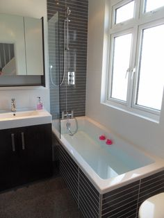 Bathrrom with high gloss linear mosaic feature tiles