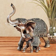 Being a typical mother figure, the Nurturing Elephant teaches her young one how to trumpet. Resin sculpture depicts two elephants, finished in brown and gray and dressed in elegant regalia. Elephant Table, Elephant Home Decor, Elephant Love, Elephant Art, Elephant Stuff, Wooden Elephant, Elephant Sculpture, Resin Sculpture, Lion Sculpture