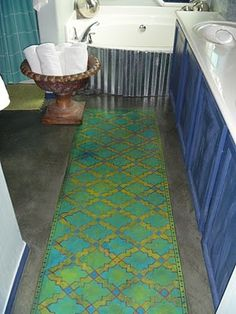 Stenciled Runner On A Concrete Bathroom Floor From Design Share Stylish Stencils Check Out The Corrugated Tub Surround