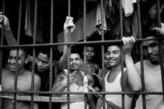 Members of the 18th street gang in a cell of the Quezaltepeque jail in El Salvador. The gang announced an end to their recruitment of children and youth and declared schools off-limits for their activities. El Salvador has struggled with gang violence for many years but recently saw a drop in the murder rate and reported with some jubilation that on 14 April nobody was murdered.