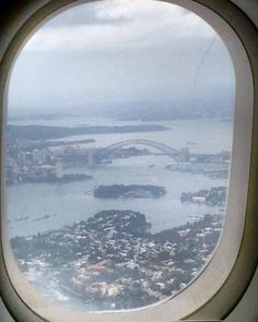 First glimpse of #Sydney albeit out of a plane window! Can't wait to see the bridge up close tomorrow. #sydneyharbourbridge #Sydney #plane #windowview #oz #a320 #jetstar #SYD by npw85 http://ift.tt/1NRMbNv