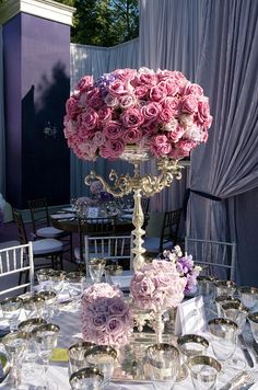 This table is topped with pomanders of roses in varying heights and pink and purple hues. would look amazing ...