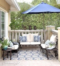 If you already have an umbrella on your deck, find a rug with that color in it. Then find a few outdoor pillows to use on chairs or a bench and you will have an inviting outdoor seating area: Outdoor Rug Magic • Kelly Bernier Designs