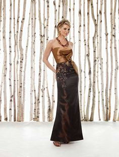 Strapless dupioni modified mermaid dress with softly curved neckline, side gathered Empire bodice features a pleated waistband with Obi-style bow, skirt adorned with side hand-beaded and embroidered detail, sweep train. Matching shawl and removable straps included. Sizes: 4 – 20