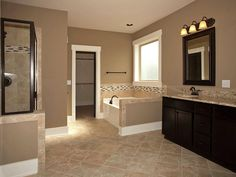 Master Bathroom-Add tile flooring, frame the mirror, stain the cabinets, change light fixtures-all to look more like this!