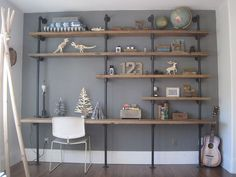 Tips for Making a DIY Industrial Pipe Shelving Unit Perfect for storage and a desk - love it!