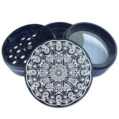 Black 55mm Multi-tooth Custom Herb Grinder. Engraved on this unique piece is a perfectly symmetrical mandala design. This smoking accessory is one of the most badass top shelf grinders in the cannabis industry today to make your own grinder check out customherbgrinders.com