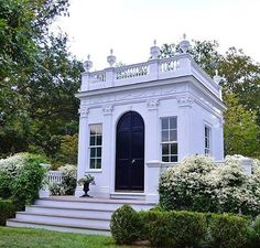 """A dear friend's small """"library"""" on his Newport property is such a perfect example of how Autumn Clematis can dress up a piece of architecture."""