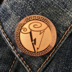 Inspired by everyones favorite demi-god, is this hard-enamel Symbol of the Gods pin. The pin features a brilliant lightning bolt striki. Lightning Bolt, Des Accents D'or, Gold Accents, Broches Disney, Jacket Pins, Hipster Outfits, Hipster Style, Disney Outfits, Cool Pins
