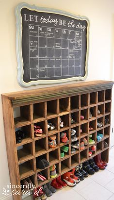 DIY Chalkboard Calendar Nice Calendar, but I am seriously in love with the shoe cubby. We need something like that for our boys! Chalkboard Calendar, Diy Chalkboard, Diy Calendar, Shoe Cubby, Kids Shoe Storage, Cubby Storage, Storage Ideas, Ideas Para Organizar, Cubbies
