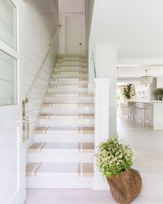 It may be small and narrow, but that doesn't mean your stairway can't get the same decorating treatment as the rest of your house. These staircase decorating ideas will give your entryway a step up. Find and save ideas about Painted stairs. Beach Cottage Style, Beach House Decor, Coastal Style, Coastal Decor, Connecticut, Painted Staircases, Painted Stairs, Style At Home, Coastal Living Rooms