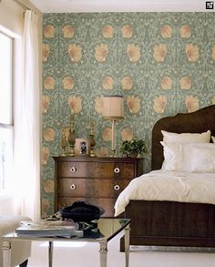 Pimpernel Wallpaper - A stunningly beautiful classic Morris style floral trellis with circular shapes and a strong symmetrical pattern within the leaves. Shown with peach flowers on a blue green. http://www.wallpaperdirect.co.uk/