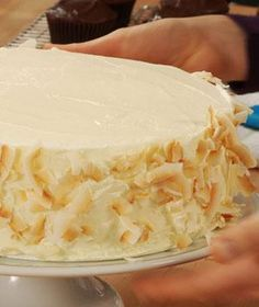 How To Decorate the Sides of a Cake | Coating the sides of your cake is a great way to conceal a not-so-perfect frosting job, and it adds dimension and fun to any cake.
